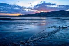 Solnedgång på Medano liten vik Royaltyfri Foto
