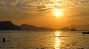 Solnedgång på Milosön Royaltyfria Bilder