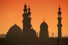 Solnedgång på minaret av Kairo arkivbild