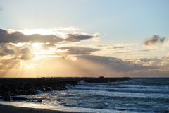 solnedgång på Nr Vorupoer på Nordsjönkusten i Danmark Arkivbilder