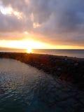 Solnedgång på Okinawa Cape Busena royaltyfri foto
