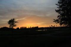 Solnedgång på parkera Fotografering för Bildbyråer