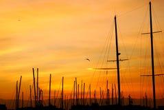 Solnedgång på pir Royaltyfri Bild