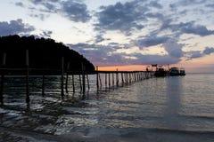 Solnedgång på pir Royaltyfri Fotografi