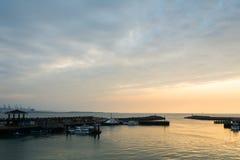 Solnedgång på port Royaltyfri Fotografi