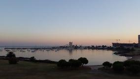 Solnedgång på port av Buceo, Uruguay Arkivbilder