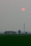 Solnedgång på Sekinchan Arkivfoton