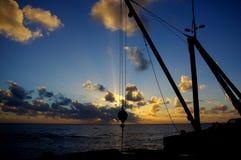 Solnedgång på Sir Robert Wharf, Alofi Arkivfoto