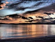 Solnedgång på sjön Leman Arkivbild