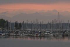 Solnedgång på skeppsdockorna Arkivbilder