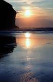 Solnedgång på strand Arkivfoton