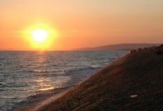 Solnedgång på stranden arkivfoto