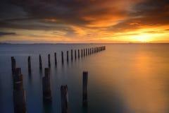 Solnedgång på stranden Fotografering för Bildbyråer