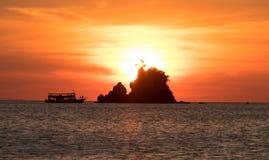 Solnedgång på stranden Arkivbilder