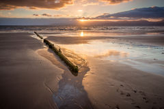 Solnedgång på stranden 2 Arkivfoton