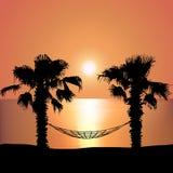 Solnedgång på stranden på hängmattan Royaltyfria Foton