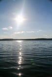 Solnedgång på Tagasuk sjön Arkivfoto