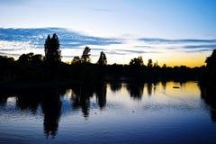 Solnedgång på Themsen Arkivbilder