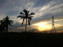 Solnedgång på vägen Arkivfoto