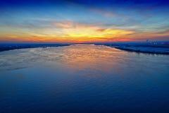Solnedgång på vattnet Fotografering för Bildbyråer
