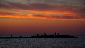 Solnedgång på vattnet Royaltyfria Bilder