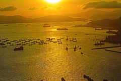 Solnedgång på Victoria Harbor hk Arkivbild