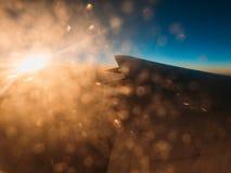 Solnedgång på vingen Arkivbild