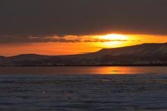 Solnedgång på vintern Lake Baikal Fotografering för Bildbyråer
