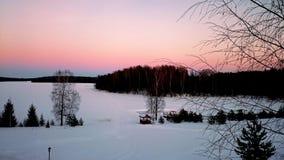 Solnedgång på vintersjön Royaltyfri Bild