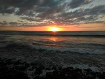 Solnedgång Playa Rompeolas Aquadillia Puerto Rico royaltyfri bild
