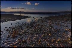 Solnedgång - Skottland HÄRLIGT SOLNEDGÅNGHAV I SKOTTLAND arkivfoto