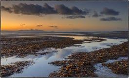 Solnedgång - Skottland HÄRLIGT SOLNEDGÅNGHAV I SKOTTLAND royaltyfri bild