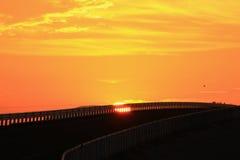 Solnedgång som ses från en bro Fotografering för Bildbyråer