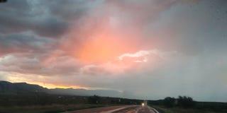 Solnedgång till och med regn fotografering för bildbyråer