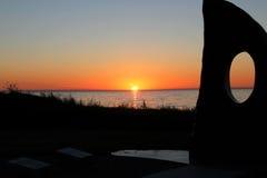 Solnedgång västra Island. Arkivfoton