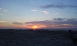 Solnedgång vid det baltiska havet royaltyfria bilder
