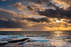 Solnedgång vid havet Royaltyfri Bild