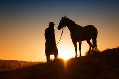 Solnedgångcowboy Arkivbilder