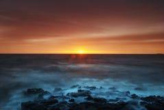 Solnedgången Arkivfoto