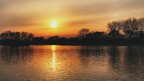 Solnedgången av Peking Houhai arkivfoto