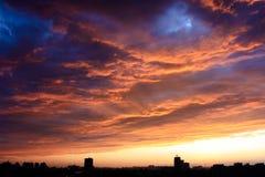 Solnedgången efter regnar Royaltyfri Bild