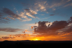Solnedgången fördunklar färgrika Sydafrika royaltyfria foton