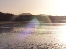 Solnedgången glittrar Arkivfoto
