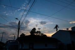 Solnedgången i byn Royaltyfria Foton