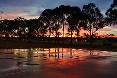 Solnedgånghimlar efter regnet Arkivbild