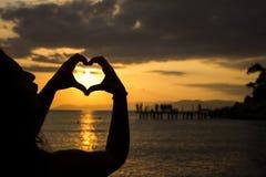 Solnedgånghjärta Arkivfoto