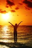 solnedgångkvinna Royaltyfri Foto