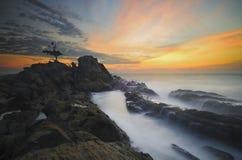 SolnedgångLabuan ö fotografering för bildbyråer