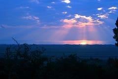 Solnedgånglandskap, flatland och hav Arkivbilder