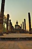 Solnedgångljus och fördärvar templet Arkivfoton